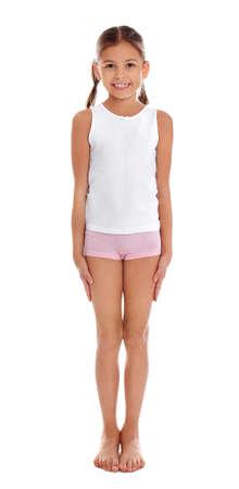 Cute little girl in underwear on white background