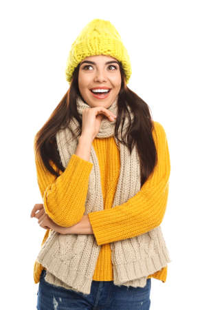 Happy young woman in warm clothes on white background. Winter vacation