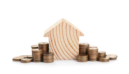 House model and coins isolated on white Foto de archivo