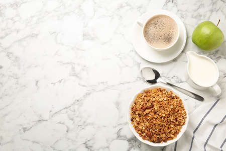Tasty healthy breakfast on marble table, flat lay. Space for text