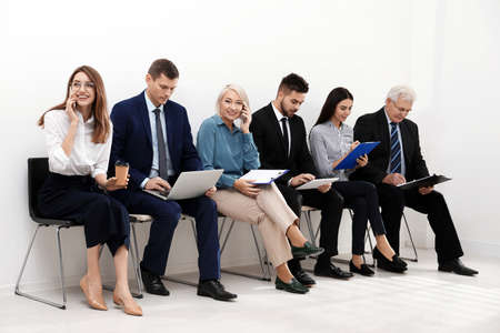 People waiting for job interview in office