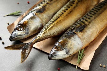 Tasty smoked fish on grey table, closeup Stock Photo