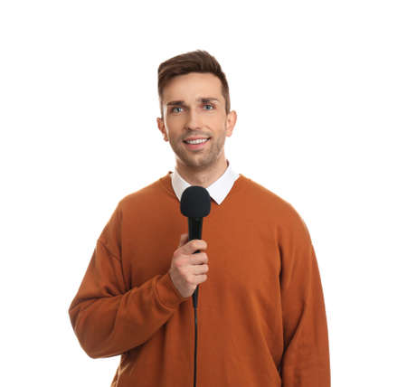 Young male journalist with microphone on white background Stock Photo