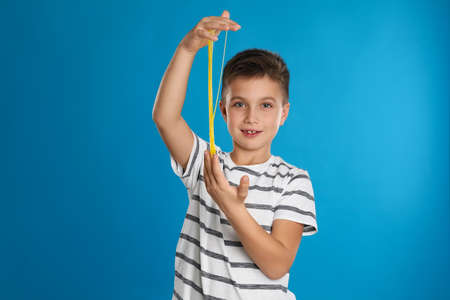 Little boy with slime on blue background