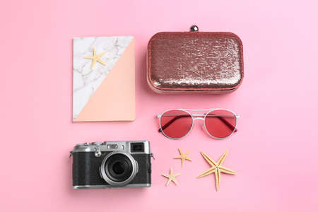 Flat lay composition with camera for professional photographer on pink background Stock Photo