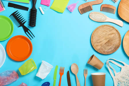 Flat lay composition with household goods on light blue background, space for text. Recycling concept Zdjęcie Seryjne