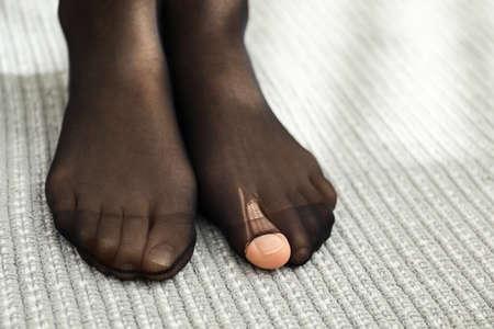 Woman wearing torn tights at home, closeup 版權商用圖片