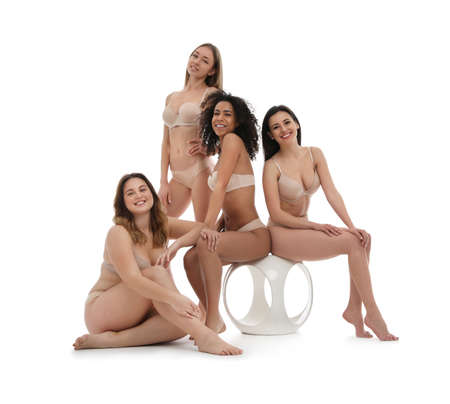 Group of women with different body types in underwear on white background Standard-Bild