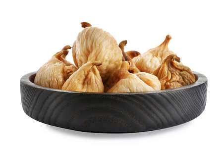 Tasty dried figs in plate isolated on white
