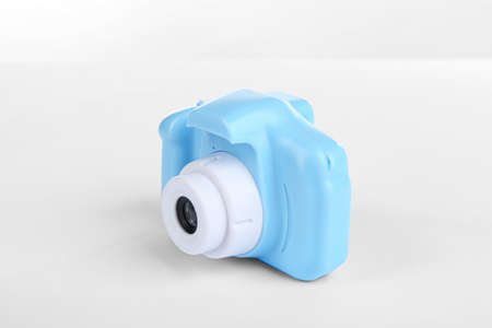 Light blue toy camera isolated on white