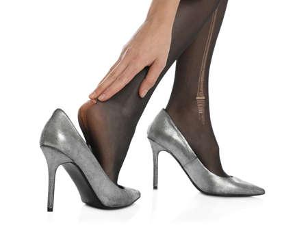Woman wearing torn tights on white background, closeup 版權商用圖片