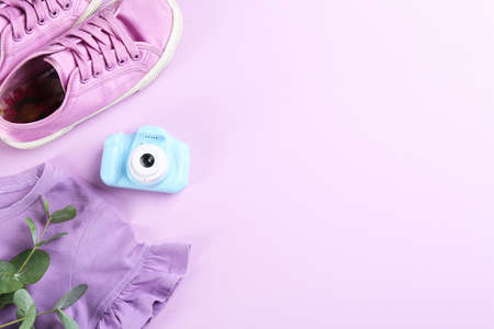 Flat lay composition with little photographer's toy camera on pink background. Space for text