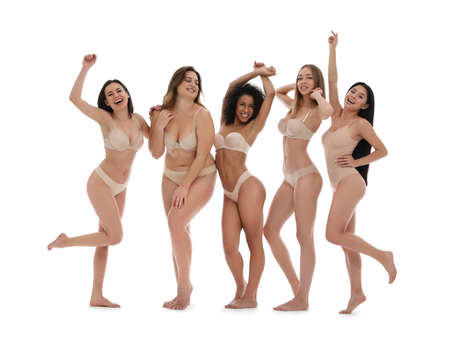 Group of women with different body types in underwear on white background