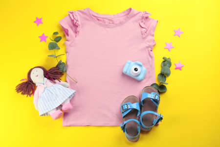 Flat lay composition with toy camera for little photographer on yellow background
