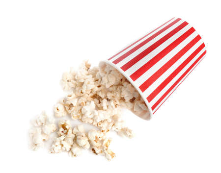 Bucket of tasty pop corn isolated on white, top view