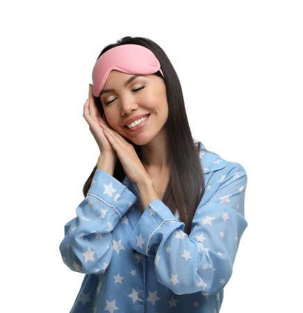 Beautiful Asian woman wearing pajamas and sleeping mask on white background. Bedtime