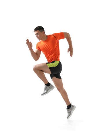 Athletic young man running on white background, side view