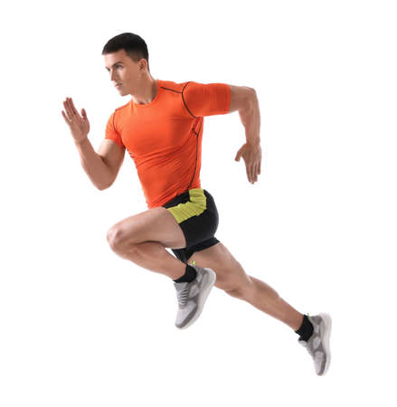 Athletic young man running on white background, side view Stock Photo