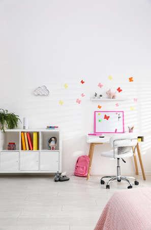 Modern child room interior with stylish furniture
