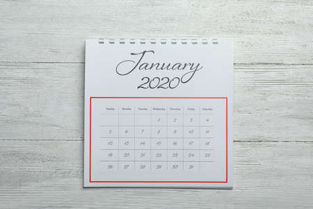 January 2020 calendar on white wooden background, top view
