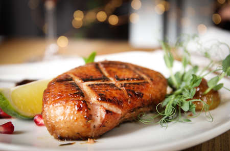 Delicious grilled duck with lime on plate, closeup