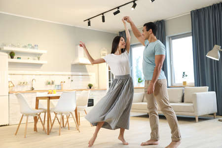 Lovely young interracial couple dancing at home Stock Photo - 137265654
