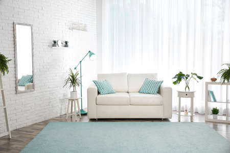 Stylish living room interior design inspired by color of the year 2020 (bleached coral)