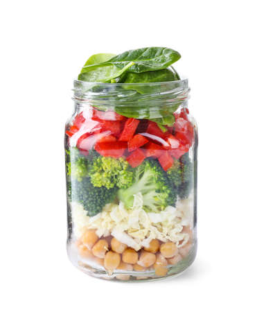 Healthy salad in glass jar isolated on white