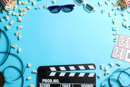 Flat lay composition with clapper board and cinema tickets on light blue background, space for text Stockfoto