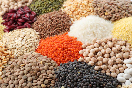 Different types of legumes and cereals as background, closeup. Organic grains Stock fotó