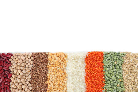 Different types of legumes and cereals on white background, top view. Organic grains Stock fotó