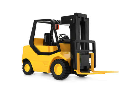 Toy forklift isolated on white. Logistics and wholesale concept Stock Photo