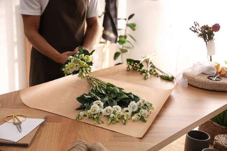 Florist making beautiful bouquet in workshop, closeup Stock Photo