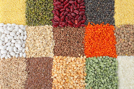 Different grains and cereals as background, top view Stock fotó