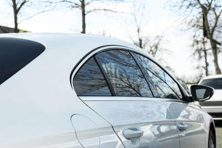 Modern car with tinting foil on window outdoors, closeup Reklamní fotografie