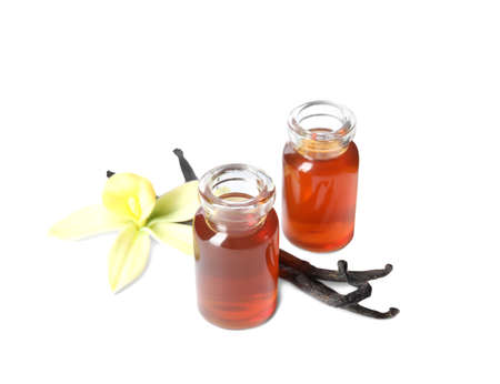 Vanilla extract, flower and dry pods isolated on white