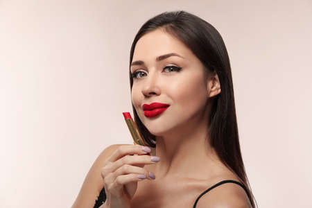 Beautiful woman with red lipstick on light background Stock Photo