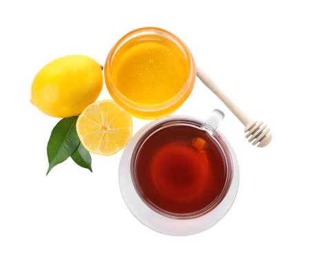 Frischer Tee und Honig auf weißem Hintergrund, Ansicht von oben Standard-Bild