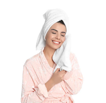Young woman wiping face with towel on white background