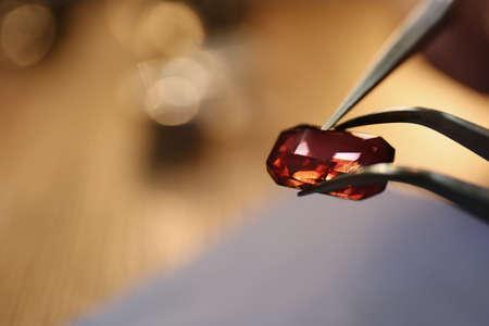 Beautiful gemstone in jeweler's workshop, closeup. Space for text 版權商用圖片