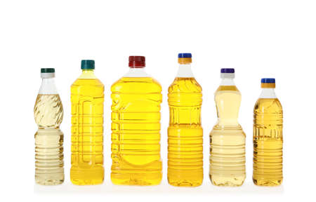 Cooking oil in different bottles isolated on white