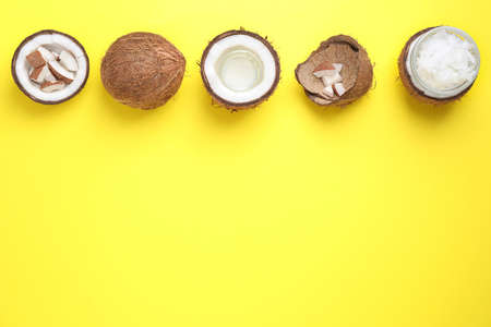 Flat lay composition with coconut oil on yellow background, space for text
