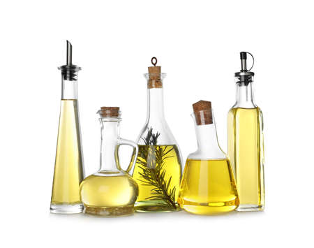 Different sorts of cooking oil in bottles isolated on white Banco de Imagens