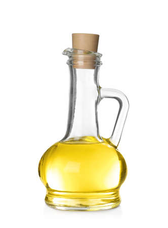 Cooking oil in glass jug isolated on white
