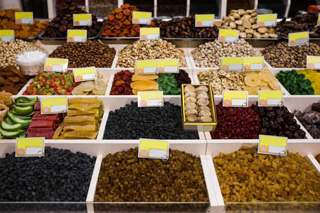 Assortment of delicious dried fruits and nuts at wholesale market Standard-Bild
