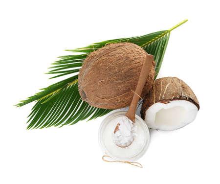 Composición con aceite de coco orgánico sobre fondo blanco, vista superior. Cocina saludable Foto de archivo