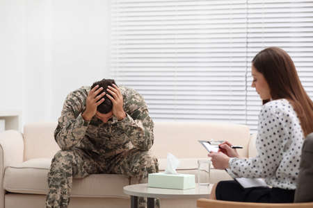 Psychotherapist working with male military officer in office