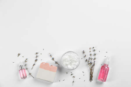 Flat lay composition with natural handmade soap and ingredients on white background. Space for text