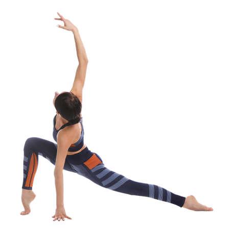 Professional young acrobat exercising on white background