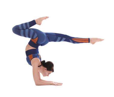 Professional young acrobat exercising on white background Stock Photo
